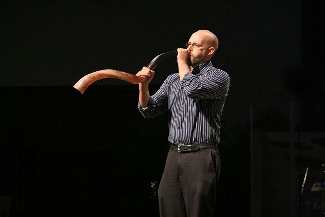 Jacob Cloud blows the shofar to call conference members to devotions.