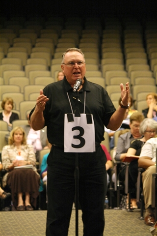Rev. Gene McIntosh asks a question of the Transition Team.